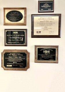 Multiple awards hanged on wall